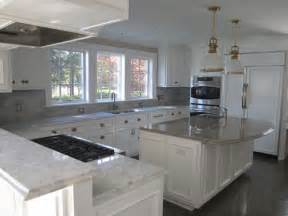 Grey Kitchen Cabinets With White Countertops by White Kitchen Cabinets Grey Granite Worktops The Maple