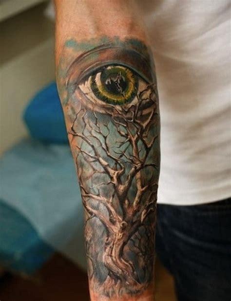 eye tattoo forearm wonderful colorful tree and eye on blue background tattoo