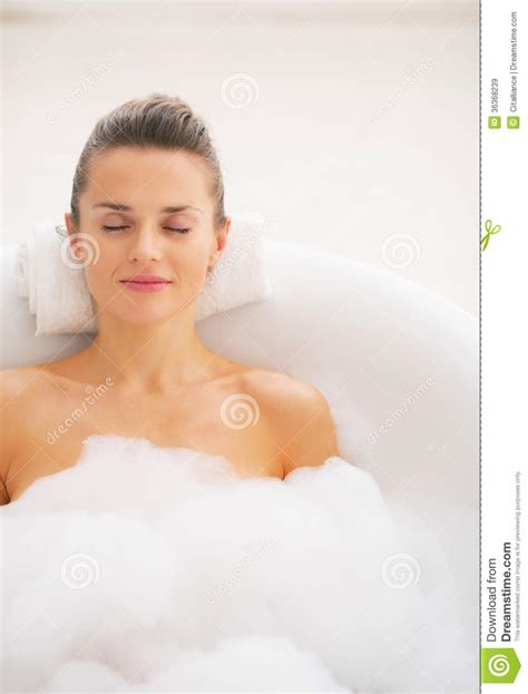 women bathtub happy young woman relaxing in bathtub royalty free stock