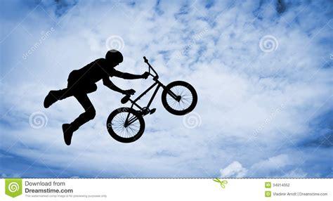 videos28771bmx bike tricks jumps how to do a bunny hop bmx tricks silhouette of a man with bmx bike stock photo image