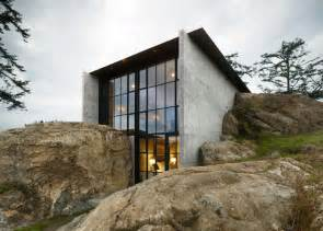 concrete homes concrete house by kundig architects cuts into a