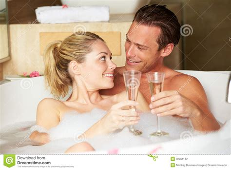 couple bathtub couple relaxing in bath drinking chagne together stock photography image 32061142