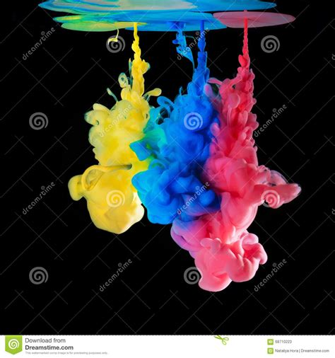 colored ink colored inks in water on black background stock photo