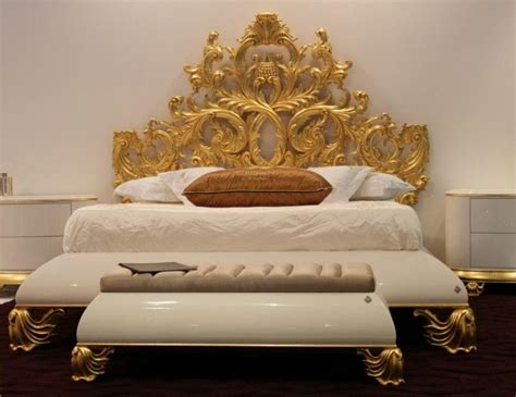 gold and glossy carved royal bedstead with