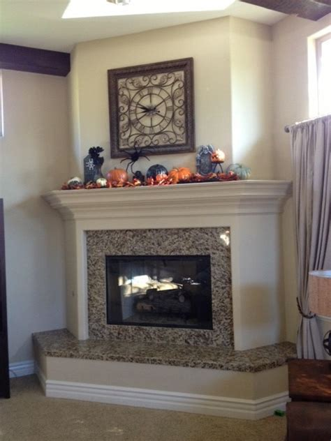 how to build a raised fireplace hearth should the mantel match the raised hearth