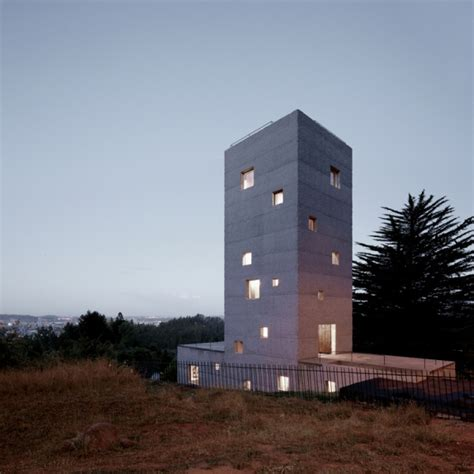 concrete tower house designed with live work space
