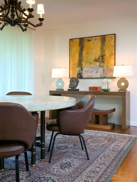 eclectic dining room  leather chairs  oriental rug
