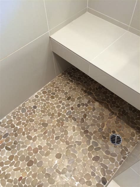 pebble tiles for bathroom sliced pebble tile spaces contemporary with bathroom sea