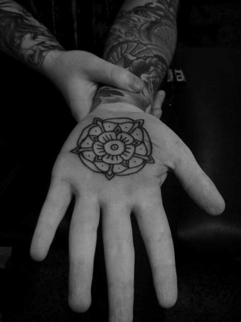 tattoo on palm of hand a on the palm of the showing a mandala flower