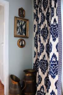 Love the curtains navy blue and white ikat pattern with greek key
