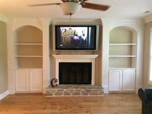 cabinet and shelves beside fireplace for the home