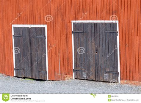 small wall with doors two black doors in a red barn wall stock image image