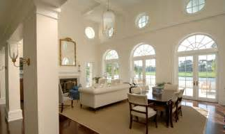 Ocular circle windows and french doors with radius transoms in this