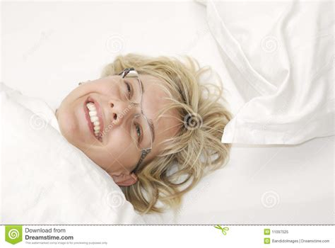 how to make a woman happy in bed happy woman in bed royalty free stock photo image 11097525