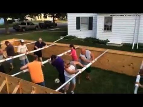 woah a life sized human foosball table youtube