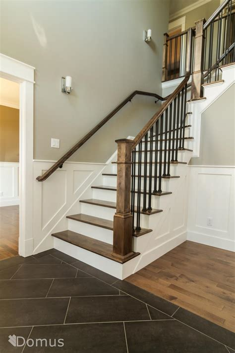 metal banister spindles staircase with white accents and black metal spindles