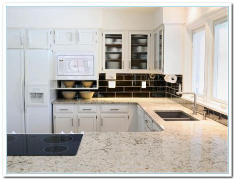 kitchen cabinets with granite countertops granite countertops with white cabinets