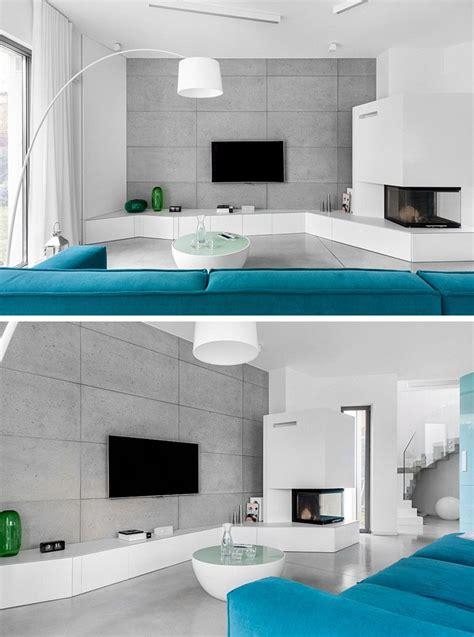 bello Arredare Soggiorno Grande #1: arredare-soggiorno-televisore-parete-pietra.jpg