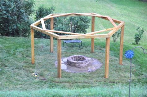 hanging swing fire pit man drives 6 posts into the ground in his backyard to