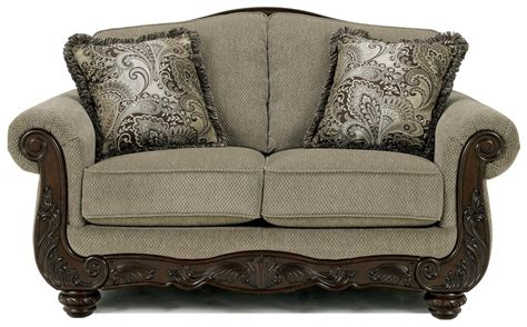 traditional sofas with wood trim signature design by ashley martinsburg meadow 5730035