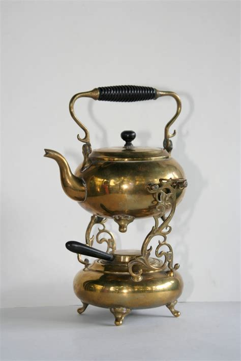 antique brass tea kettle and warmer on decorative stand