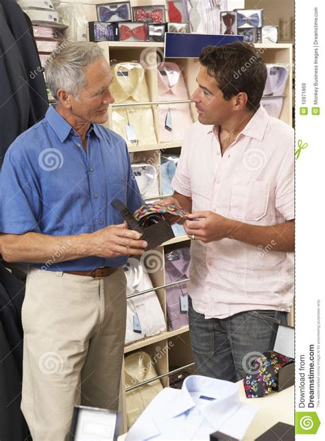customer in clothing store with sales assistant royalty free stock images image 10971869