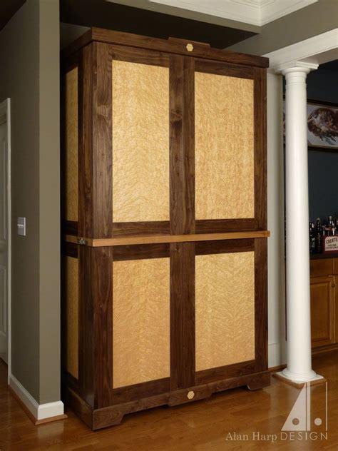 hand crafted custom walnut  birdseye maple liquor cabinet bar  alan harp design