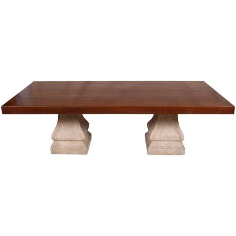 large scale oak  cast stone pedestal dining table