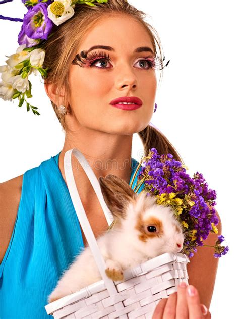 easter time avarde look hairstles woman in easter style holding rabbit and flowers in basket