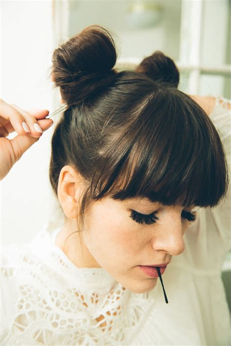 hair into small buns once dry remove buns and finger brush your hair twisted double buns tutorial come to yoga with me