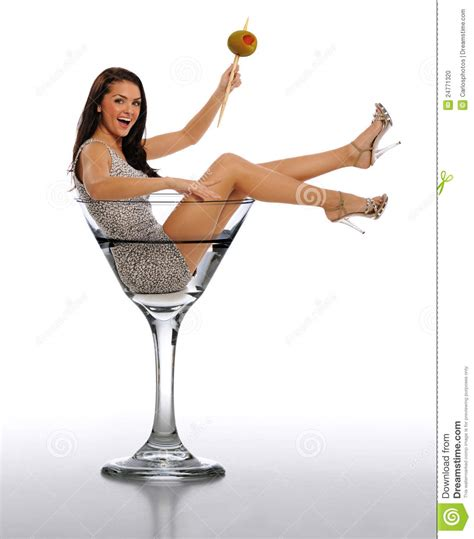 martini woman young brunette woman in a martini glass stock photo