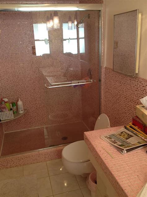 Retro Pink Bathroom Ideas pink and metallic gold mosaic tile in this vintage