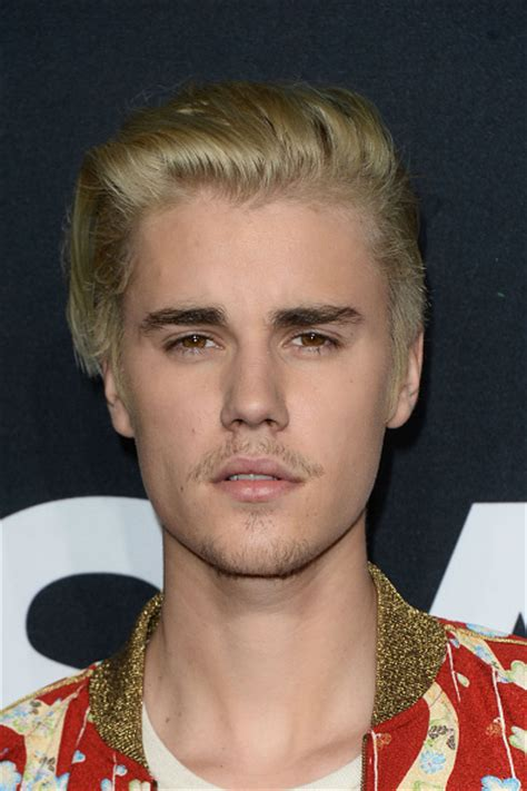justin bieber admits covering selena gomez tattoo watch