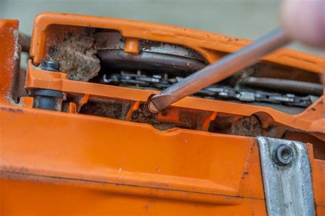 How To Adjust A Husqvarna Chainsaw Oiler With Pictures