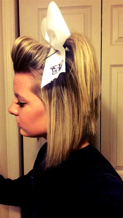 cheerleading hairstyles how to do half up cheer hair with bow impression