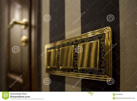 soft click light switch golden button light switch stock photo image 50098050