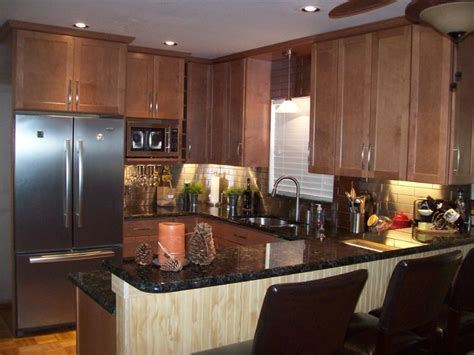 Kitchen Backsplash Pictures With Maple Cabinets by Remodeled Kitchen With Stainless Steel Backsplash And