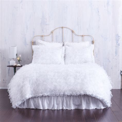 white ruffled duvet cover with rosette trim chenille top shabby chic bedroom los angeles