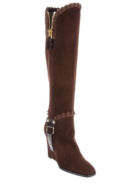 brown knee high boots cesare paciotti wedge knee high boot in brown lyst