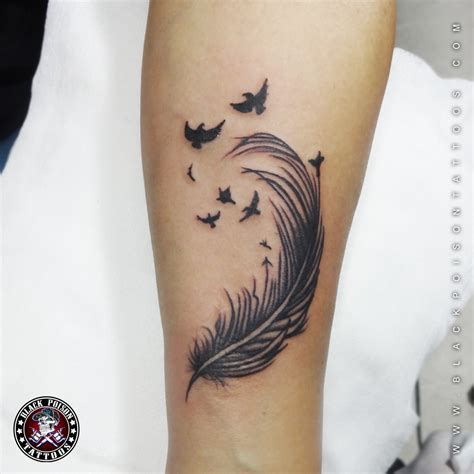 simple arm tattoos the black feather above looks cool on the arm and