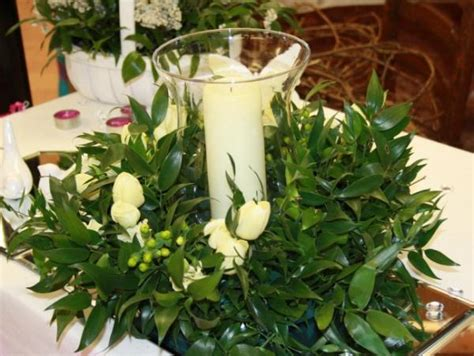 majority greenery centerpieces to help reduce floral cost