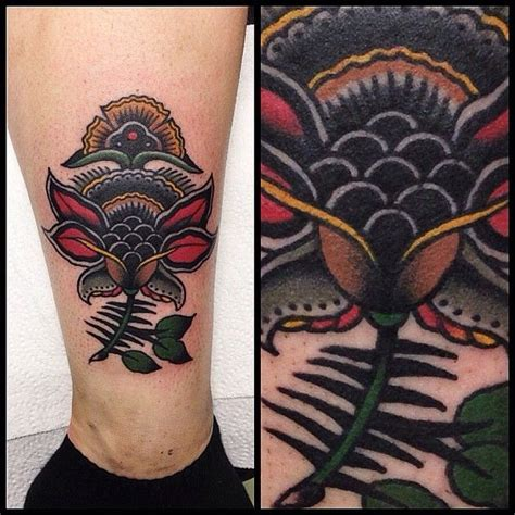 traditional flower tattoo by james mckenna tattoos