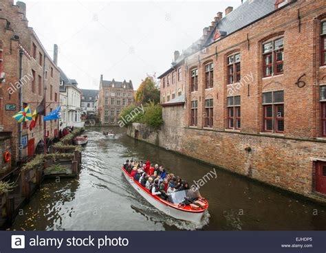 boat tour in bruges canal boat tour in bruges belgium stock photo royalty