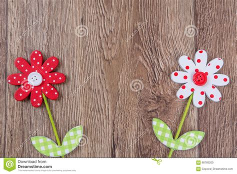 Handmade Wooden Flowers - creative handmade flowers on a wooden background stock