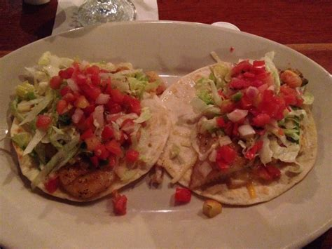 Our Signature Fish Tacos Topped With Lettuce And Pica De Litchfield Fish House