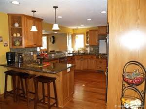 Kitchen Remodel Ideas With Oak Cabinets by Kitchen Redo Oak Cabinets Yellow Walls Black Counters
