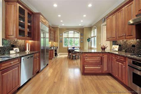 medium brown cabinets with granite countertops baltic brown granite countertop with medium wood cherry