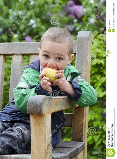 eating bench child eating apple stock photo image 40039356