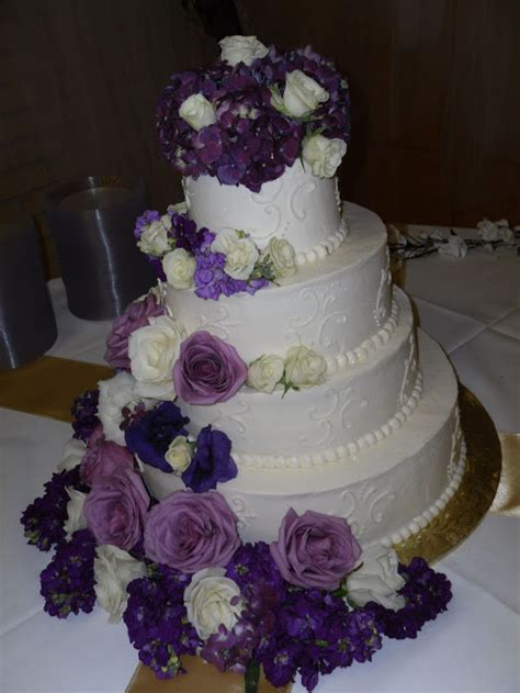 White wedding cake with purple Flowers Gallery Picture
