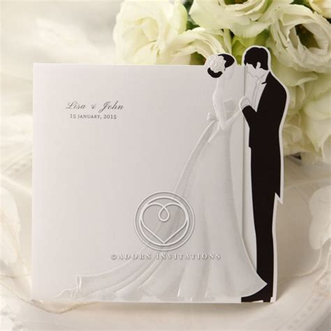 difference between day and evening wedding invitations a and groom adorn an invitation for a modern wedding